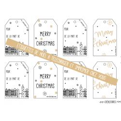 planche d'étiquettes de noel dorées avec un village